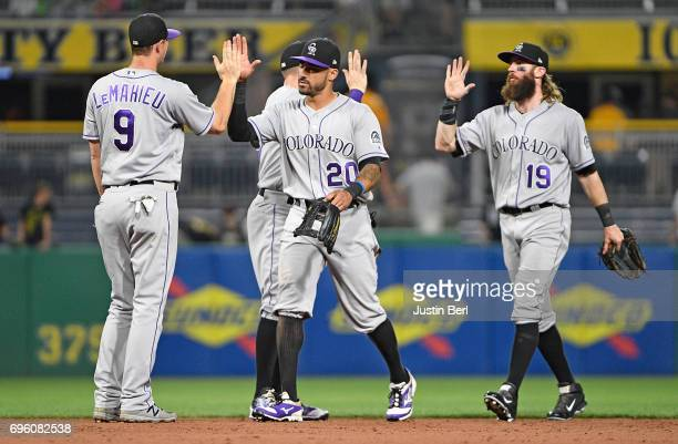Ian Desmond of the Colorado Rockies high fives with DJ LeMahieu after the final out in the Colorado Rockies 51 win over the Pittsburgh Pirates at PNC...