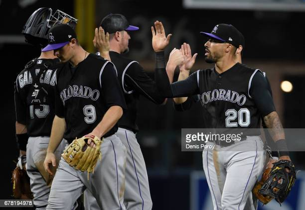 Ian Desmond of the Colorado Rockies right highfives Dustin Garneau after the Rockies beat the San Diego Padres 113 in a baseball game at PETCO Park...