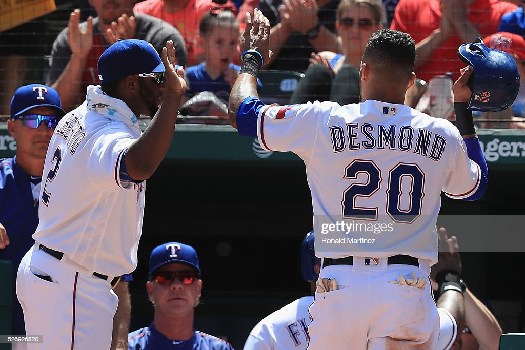 Ian Desmond #20 of the Texas Rangers celebrates a run with Hanser Alberto #2 in the fourth inning against the Los Angeles Angels at Globe Life Park in Arlington on May 1, 2016 in Arlington, Texas.