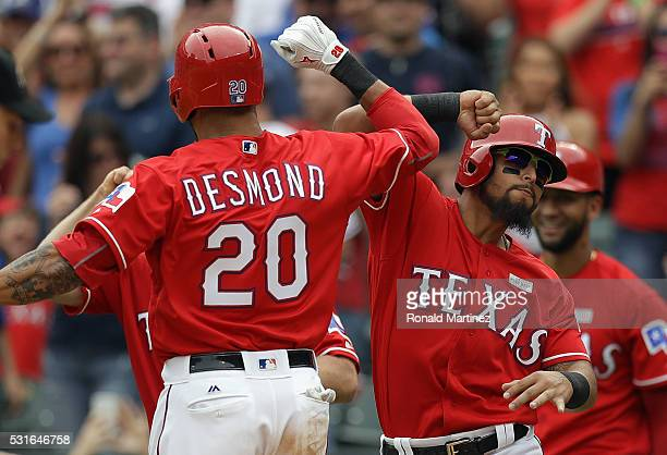 Ian Desmond of the Texas Rangers celebrates his threerun homerun with Rougned Odor in the seventh inning against the Toronto Blue Jays at Globe Life...