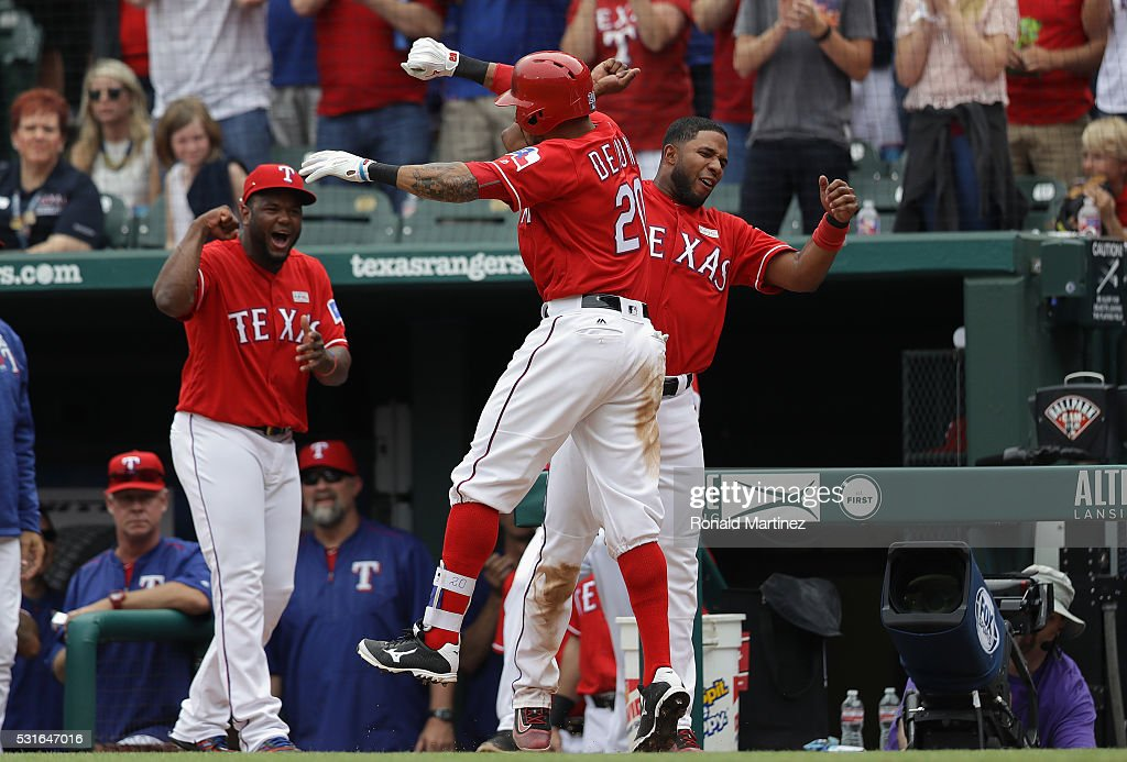Ian Desmond of the Texas Rangers celebrates his threerun homerun with Elvis Andrus in the seventh inning against the Toronto Blue Jays at Globe Life...
