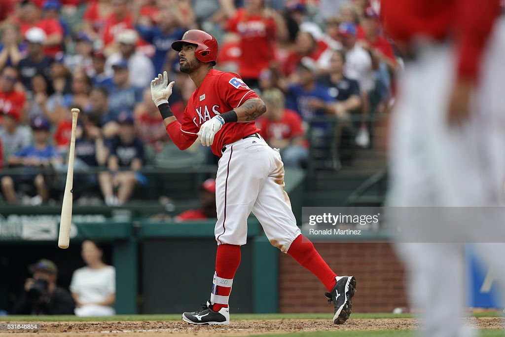 <a gi-track='captionPersonalityLinkClicked' href=/galleries/search?phrase=Ian+Desmond&family=editorial&specificpeople=835572 ng-click='$event.stopPropagation()'>Ian Desmond</a> #20 of the Texas Rangers hits a three-run homerun in the seventh innning against the Toronto Blue Jays at Globe Life Park in Arlington on May 15, 2016 in Arlington, Texas.