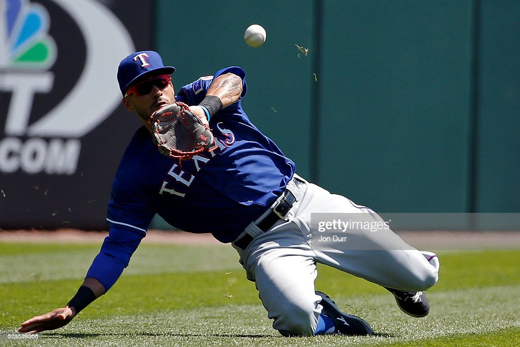 <a gi-track='captionPersonalityLinkClicked' href=/galleries/search?phrase=Ian+Desmond&family=editorial&specificpeople=835572 ng-click='$event.stopPropagation()'>Ian Desmond</a> #20 of the Texas Rangers makes a catch for an out during the first inning against the Chicago White Sox at U.S. Cellular Field on April 23, 2016 in Chicago, Illinois.