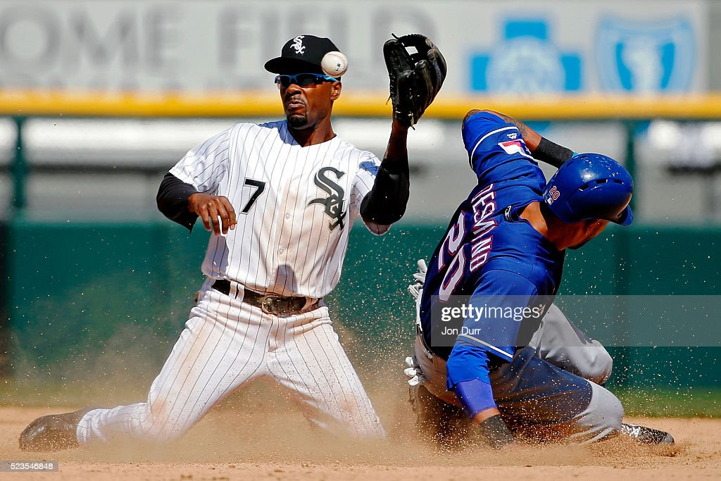 Ian Desmond #20 of the Texas Rangers steals second base as Jimmy Rollins #7 of the Chicago White Sox is unable to make the catch during the seventh inning at U.S. Cellular Field on April 23, 2016 in Chicago, Illinois.