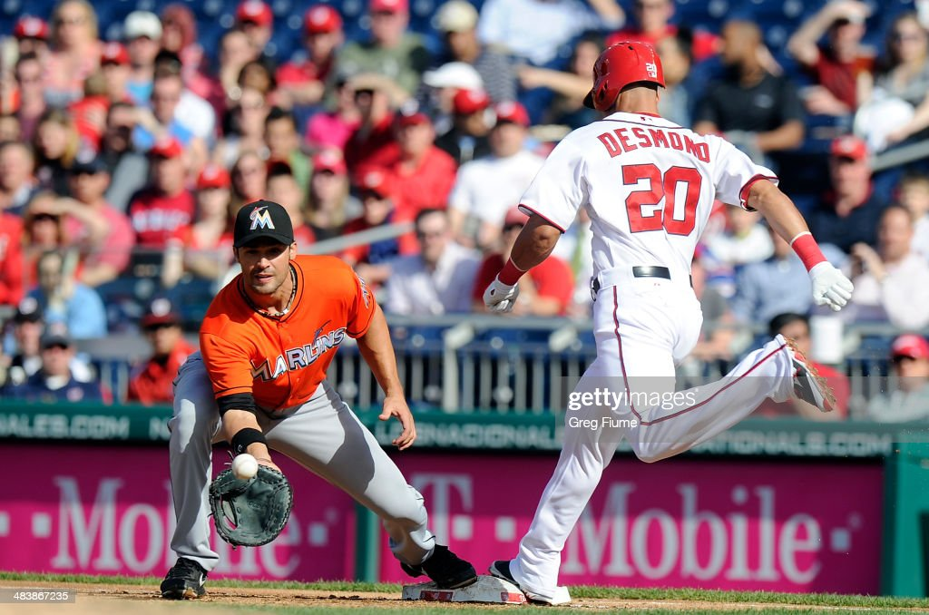 <a gi-track='captionPersonalityLinkClicked' href=/galleries/search?phrase=Ian+Desmond&family=editorial&specificpeople=835572 ng-click='$event.stopPropagation()'>Ian Desmond</a> #20 of the Washington Nationals beats the throw to <a gi-track='captionPersonalityLinkClicked' href=/galleries/search?phrase=Garrett+Jones&family=editorial&specificpeople=835861 ng-click='$event.stopPropagation()'>Garrett Jones</a> #46 of the Miami Marlins for a single in the second inning at Nationals Park on April 10, 2014 in Washington, DC.