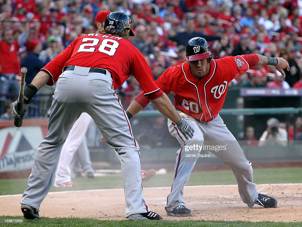 <a gi-track='captionPersonalityLinkClicked' href=/galleries/search?phrase=Ian+Desmond&family=editorial&specificpeople=835572 ng-click='$event.stopPropagation()'>Ian Desmond</a> #20 of the Washington Nationals celebrates scoring with teammate <a gi-track='captionPersonalityLinkClicked' href=/galleries/search?phrase=Jayson+Werth&family=editorial&specificpeople=206490 ng-click='$event.stopPropagation()'>Jayson Werth</a> #28 after Desmond was singled in by Jordan Zimmermann #27 in the second inning against the St. Louis Cardinals during Game Two of the National League Division Series at Busch Stadium on October 8, 2012 in St Louis, Missouri.