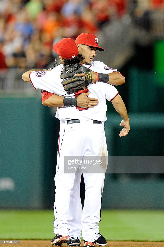 Ian Desmond #20 of the Washington Nationals celebrates with Anthony Rendon #6 after a 2-1 victory against the Colorado Rockies at Nationals Park on June 21, 2013 in Washington, DC.