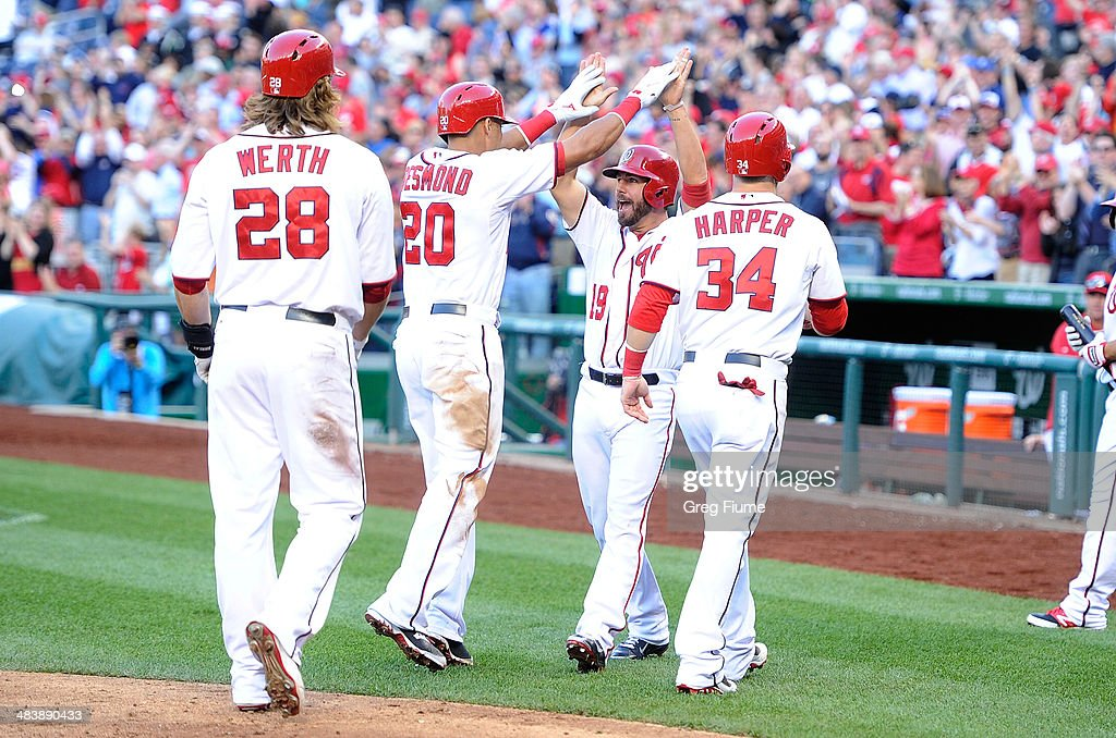 Ian Desmond #20 of the Washington Nationals celebrates with Jayson Werth #28, Kevin Frandsen #19, and Bryce Harper #34 after hitting a grand slam in the eighth inning against the Miami Marlins at Nationals Park on April 10, 2014 in Washington, DC.