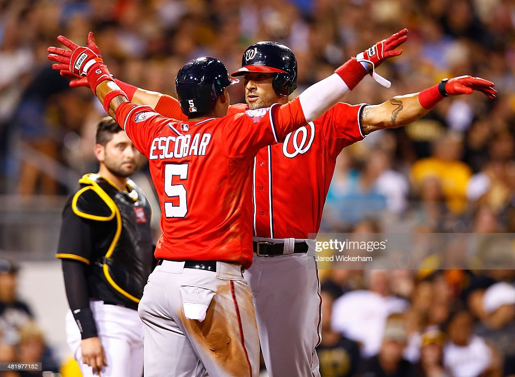 <a gi-track='captionPersonalityLinkClicked' href=/galleries/search?phrase=Ian+Desmond&family=editorial&specificpeople=835572 ng-click='$event.stopPropagation()'>Ian Desmond</a> #20 of the Washington Nationals celebrates with teammate <a gi-track='captionPersonalityLinkClicked' href=/galleries/search?phrase=Yunel+Escobar&family=editorial&specificpeople=757358 ng-click='$event.stopPropagation()'>Yunel Escobar</a> #5 after hitting a two run home run in the seventh inning against the Pittsburgh Pirates during the game at PNC Park on July 25, 2015 in Pittsburgh, Pennsylvania.
