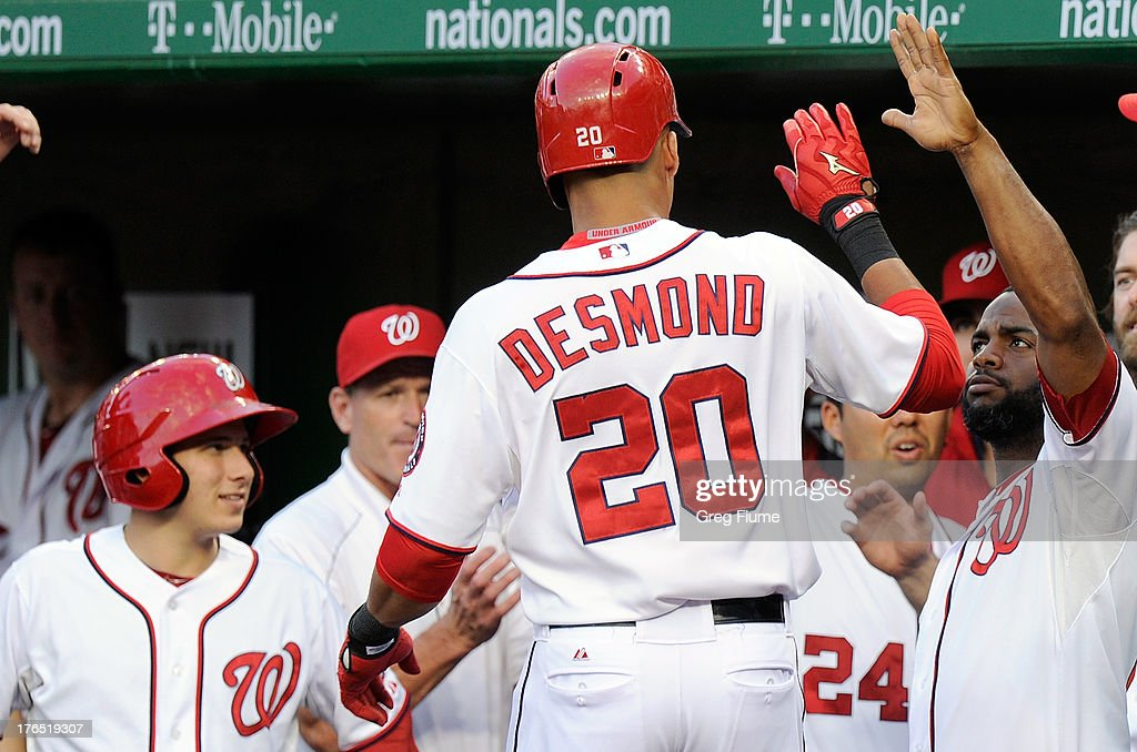 <a gi-track='captionPersonalityLinkClicked' href=/galleries/search?phrase=Ian+Desmond&family=editorial&specificpeople=835572 ng-click='$event.stopPropagation()'>Ian Desmond</a> #20 of the Washington Nationals celebrates with teammates after hitting a home run in the second inning against the San Francisco Giants at Nationals Park on August 14, 2013 in Washington, DC.