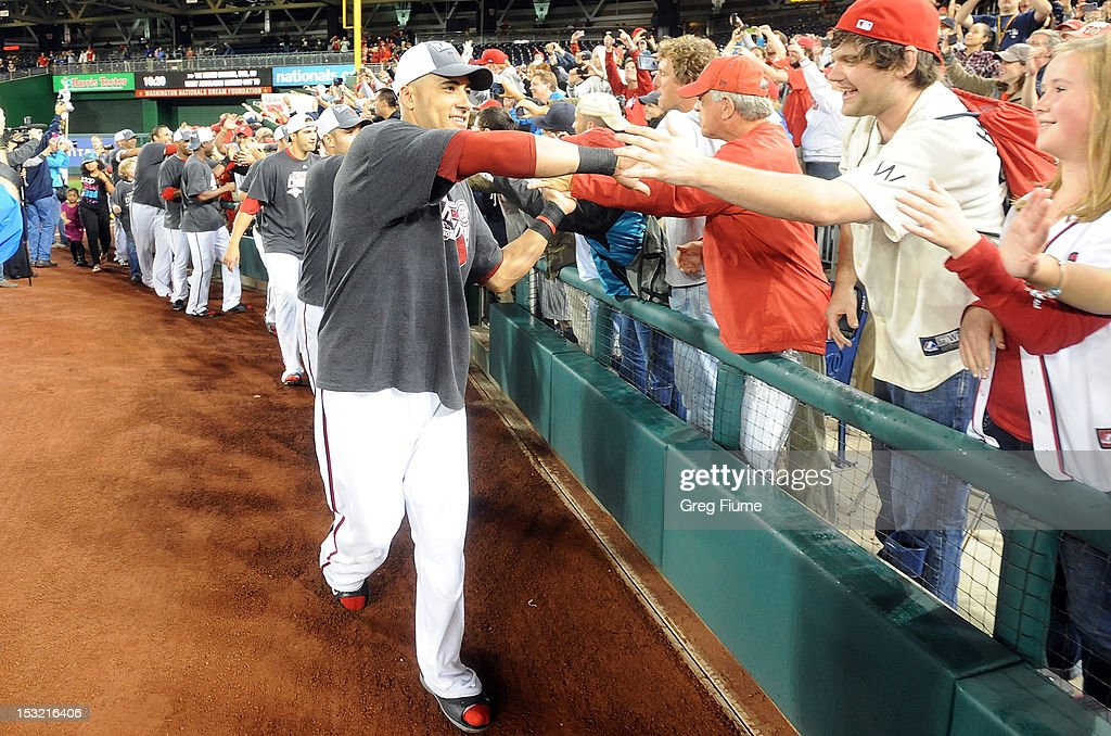 <a gi-track='captionPersonalityLinkClicked' href=/galleries/search?phrase=Ian+Desmond&family=editorial&specificpeople=835572 ng-click='$event.stopPropagation()'>Ian Desmond</a> #20 of the Washington Nationals celebrates with the crowd after winning the National League East Division Championship after the game against the Philadelphia Phillies at Nationals Park on October 1, 2012 in Washington, DC.