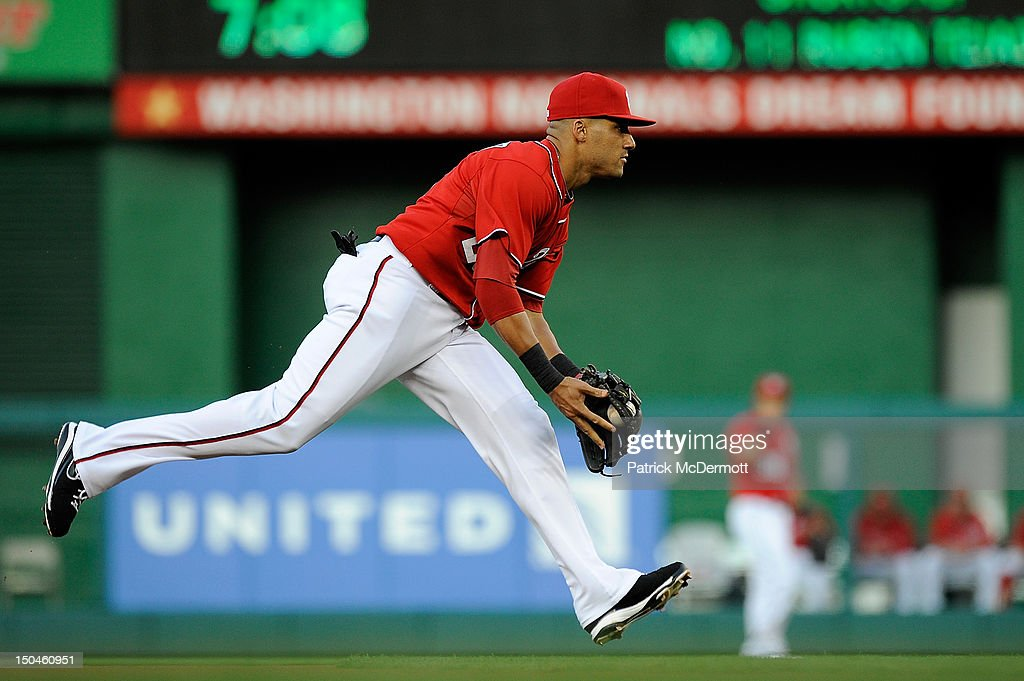 <a gi-track='captionPersonalityLinkClicked' href=/galleries/search?phrase=Ian+Desmond&family=editorial&specificpeople=835572 ng-click='$event.stopPropagation()'>Ian Desmond</a> #20 of the Washington Nationals fields a ball hit by Ruben Tejada #11 of the New York Mets during a game at Nationals Park on August 18, 2012 in Washington, DC.