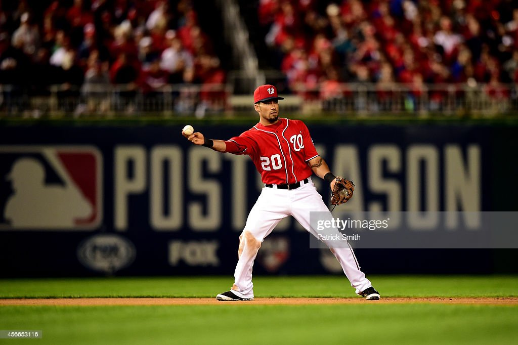 <a gi-track='captionPersonalityLinkClicked' href=/galleries/search?phrase=Ian+Desmond&family=editorial&specificpeople=835572 ng-click='$event.stopPropagation()'>Ian Desmond</a> #20 of the Washington Nationals fields the ball in the sixth inning against Gregor Blanco #7 of the San Francisco Giants during Game Two of the National League Division Series at Nationals Park on October 4, 2014 in Washington, DC.