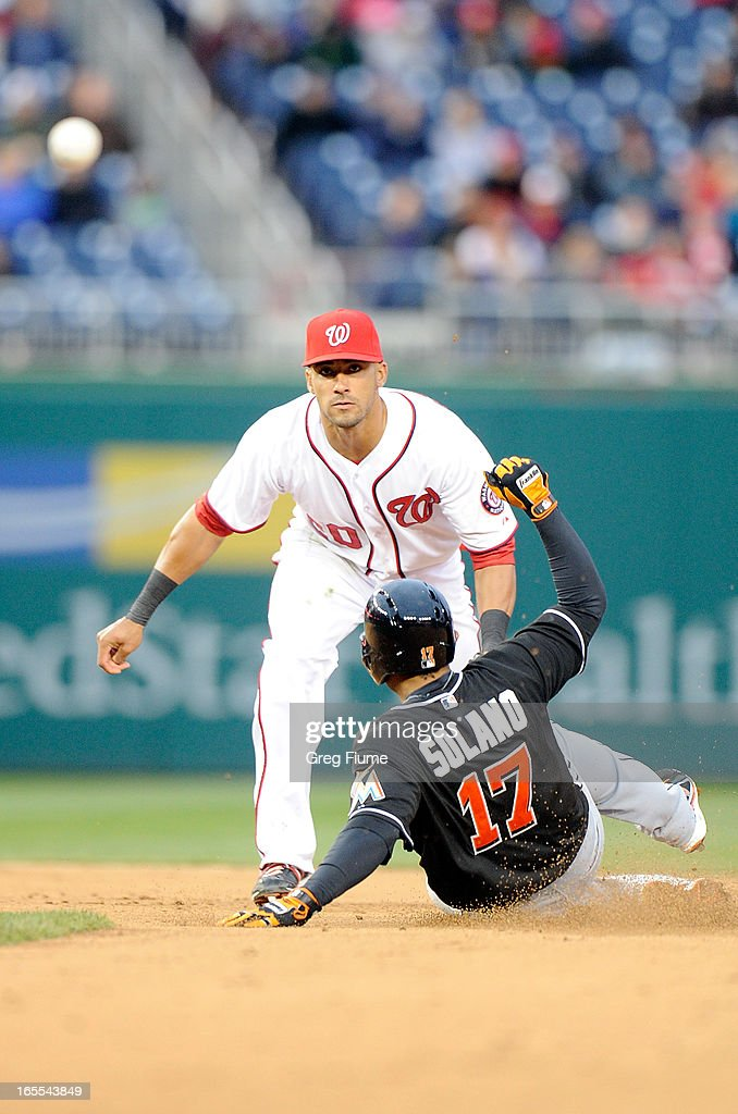 Ian Desmond #20 of the Washington Nationals forces out Donovan Solano #17 of the Miami Marlins at second base to start a double play in the ninth inning at Nationals Park on April 4, 2013 in Washington, DC.