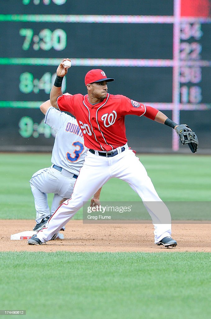 <a gi-track='captionPersonalityLinkClicked' href=/galleries/search?phrase=Ian+Desmond&family=editorial&specificpeople=835572 ng-click='$event.stopPropagation()'>Ian Desmond</a> #20 of the Washington Nationals forces out <a gi-track='captionPersonalityLinkClicked' href=/galleries/search?phrase=Omar+Quintanilla&family=editorial&specificpeople=551479 ng-click='$event.stopPropagation()'>Omar Quintanilla</a> #3 of the New York Mets to start a double play in the fifth inning at Nationals Park on July 26, 2013 in Washington, DC. New York won the game 11-0.