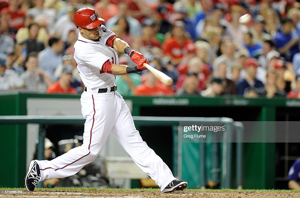 <a gi-track='captionPersonalityLinkClicked' href=/galleries/search?phrase=Ian+Desmond&family=editorial&specificpeople=835572 ng-click='$event.stopPropagation()'>Ian Desmond</a> #20 of the Washington Nationals hits a home run in the seventh inning against the Colorado Rockies at Nationals Park on June 21, 2013 in Washington, DC. Washington won the game 2-1.