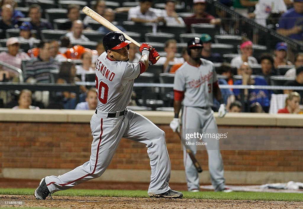 <a gi-track='captionPersonalityLinkClicked' href=/galleries/search?phrase=Ian+Desmond&family=editorial&specificpeople=835572 ng-click='$event.stopPropagation()'>Ian Desmond</a> #20 of the Washington Nationals hits a RBI double in the ninth inning against the New York Mets at Citi Field on June 28, 2013 at Citi Field in the Flushing neighborhood of the Queens borough of New York City. Nationals defeated the Mets 6-4.