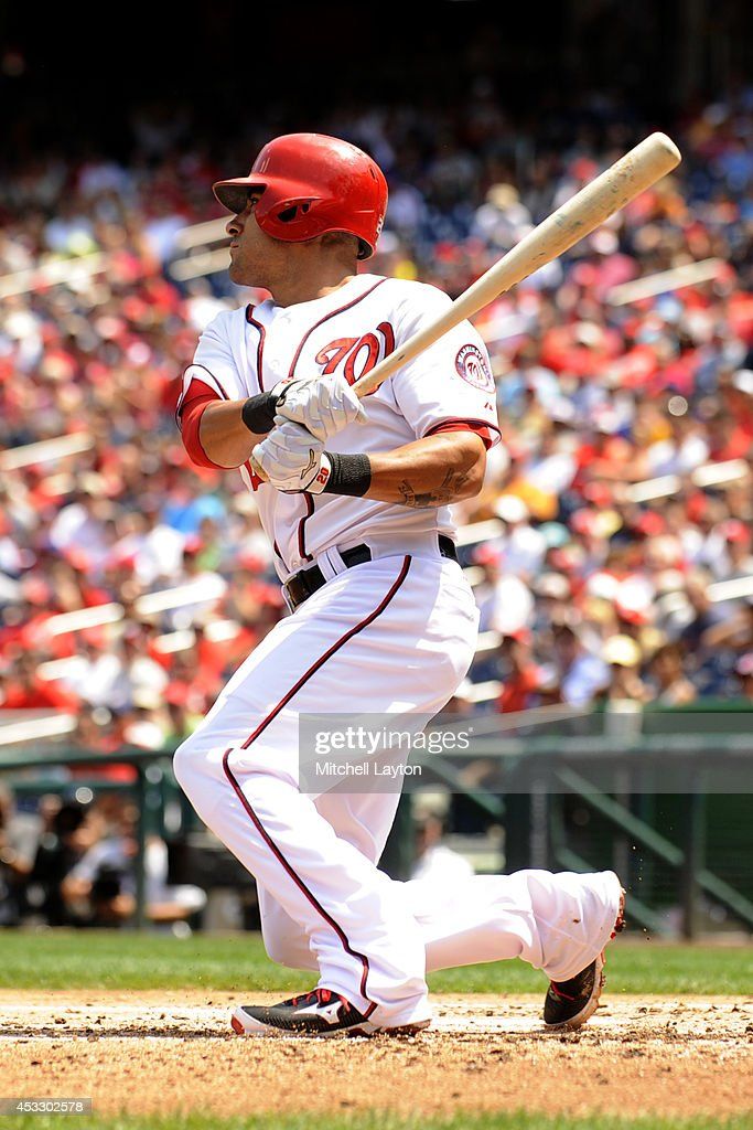 <a gi-track='captionPersonalityLinkClicked' href=/galleries/search?phrase=Ian+Desmond&family=editorial&specificpeople=835572 ng-click='$event.stopPropagation()'>Ian Desmond</a> #20 of the Washington Nationals hits a two run home run in the second inning during a baseball game against the New York Mets on August 7, 2014 at Nationals Park in Washington, DC.
