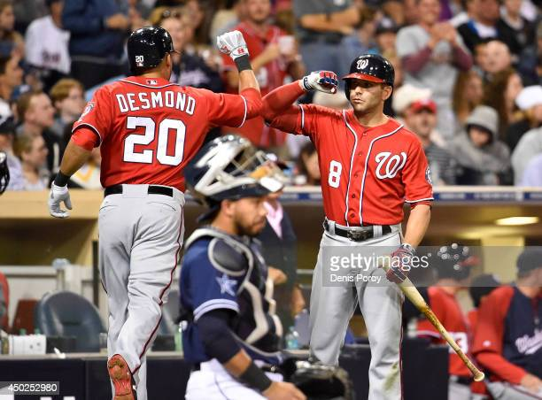 Ian Desmond of the Washington Nationals is congratulated by Danny Espinosa after he hit a tworun home run during the seventh inning of a baseball...