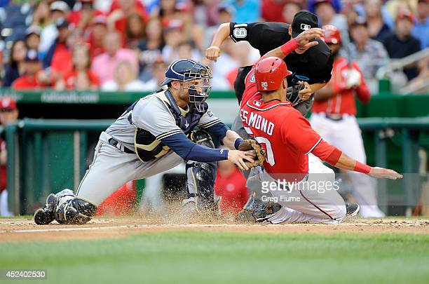 Ian Desmond of the Washington Nationals is tagged out at home plate in the first inning by Jonathan Lucroy of the Milwaukee Brewers at Nationals Park...