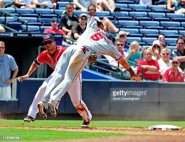 Ian Desmond of the Washington Nationals is tagged out at third base by Martin Prado of the Atlanta Braves at Turner Field on July 17 2011 in Atlanta...