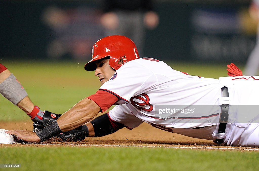 <a gi-track='captionPersonalityLinkClicked' href=/galleries/search?phrase=Ian+Desmond&family=editorial&specificpeople=835572 ng-click='$event.stopPropagation()'>Ian Desmond</a> #20 of the Washington Nationals is tagged out trying to dive back into first base in the eighth inning against the Cincinnati Reds at Nationals Park on April 25, 2013 in Washington, DC.