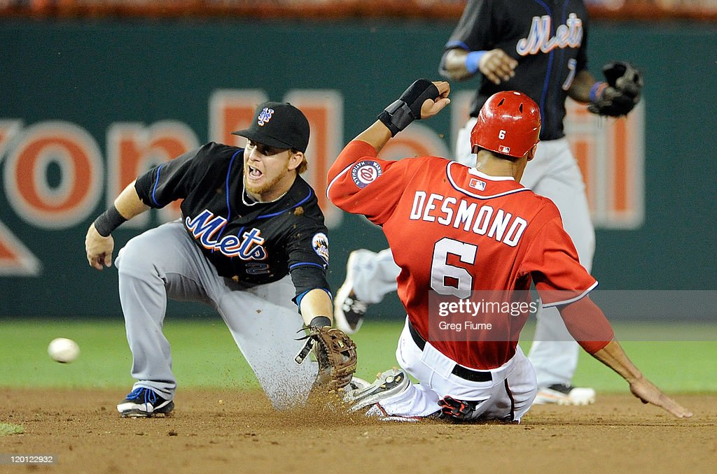 <a gi-track='captionPersonalityLinkClicked' href=/galleries/search?phrase=Ian+Desmond&family=editorial&specificpeople=835572 ng-click='$event.stopPropagation()'>Ian Desmond</a> #6 of the Washington Nationals is tagged out trying to steal second base by Justin Turner #2 of the New York Mets at Nationals Park on July 30, 2011 in Washington, DC. The Nationals won the game 3-0.