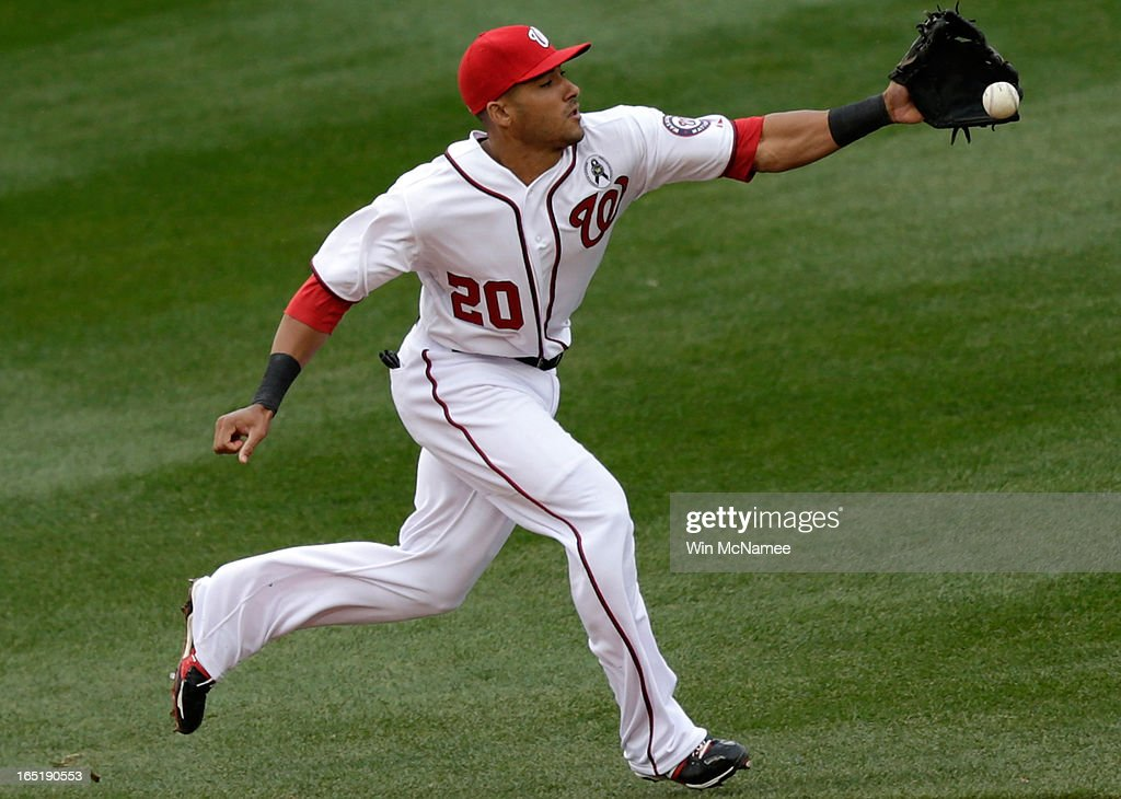 Ian Desmond #20 of the Washington Nationals is unable to field a hard gorunder that went for a base hit in the seventh inning during the Opening Day game against the Miami Marlins at Nationals Park on Monday, April 1, 2013 in Washington, DC.