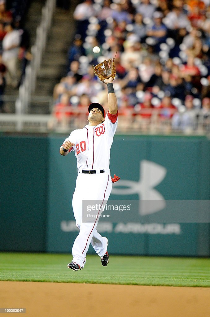 <a gi-track='captionPersonalityLinkClicked' href=/galleries/search?phrase=Ian+Desmond&family=editorial&specificpeople=835572 ng-click='$event.stopPropagation()'>Ian Desmond</a> #20 of the Washington Nationals makes a catch in the fifth inning against the Chicago White Sox at Nationals Park on April 11, 2013 in Washington, DC.