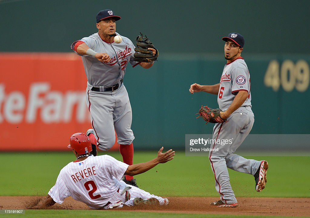<a gi-track='captionPersonalityLinkClicked' href=/galleries/search?phrase=Ian+Desmond&family=editorial&specificpeople=835572 ng-click='$event.stopPropagation()'>Ian Desmond</a> #20 of the Washington Nationals puts out <a gi-track='captionPersonalityLinkClicked' href=/galleries/search?phrase=Ben+Revere&family=editorial&specificpeople=6826641 ng-click='$event.stopPropagation()'>Ben Revere</a> #2 of the Philadelphia Phillies at second base on a double play in the first inning as Anthony Rendon #6 watches at Citizens Bank Park on July 9, 2013 in Philadelphia, Pennsylvania.