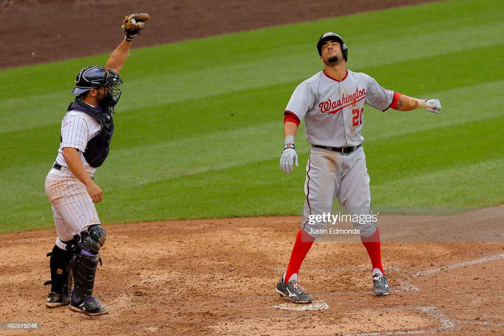 Ian Desmond #20 of the Washington Nationals reacts after striking out with the bases loaded as catcher Michael McKenry #8 of the Colorado Rockies raises his glove in triumph to end the game at Coors Field on July 23, 2014 in Denver, Colorado. The Rockies defeated the Nationals 6-4.