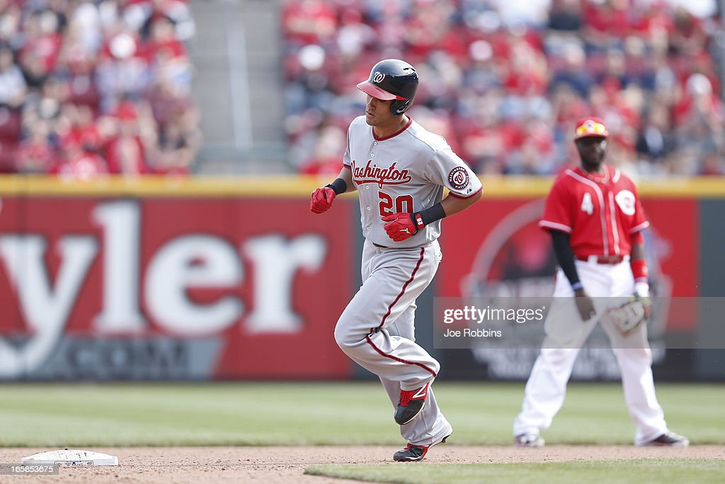 Ian Desmond #20 of the Washington Nationals rounds the bases after hitting a solo home run to break a tie game in the 11th inning against the Cincinnati Reds at Great American Ball Park on April 6, 2013 in Cincinnati, Ohio. The Nationals won 7-6.