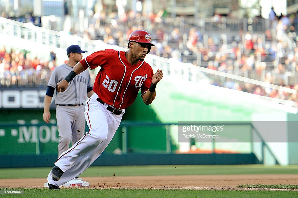 <a gi-track='captionPersonalityLinkClicked' href=/galleries/search?phrase=Ian+Desmond&family=editorial&specificpeople=835572 ng-click='$event.stopPropagation()'>Ian Desmond</a> #20 of the Washington Nationals rounds third base on his way to score the game winning run on a single by Ryan Zimmerman #11 in the seventh inning of a game against the San Diego Padres at Nationals Park on July 6, 2013 in Washington, DC.