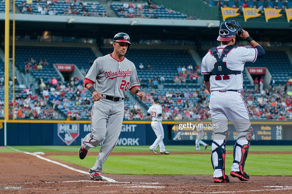 <a gi-track='captionPersonalityLinkClicked' href=/galleries/search?phrase=Ian+Desmond&family=editorial&specificpeople=835572 ng-click='$event.stopPropagation()'>Ian Desmond</a> #20 of the Washington Nationals scores against the Atlanta Braves during the 2nd inning at Turner Field on April 29, 2013 in Atlanta, Georgia. The Braves defeated the Nationals 3-2.