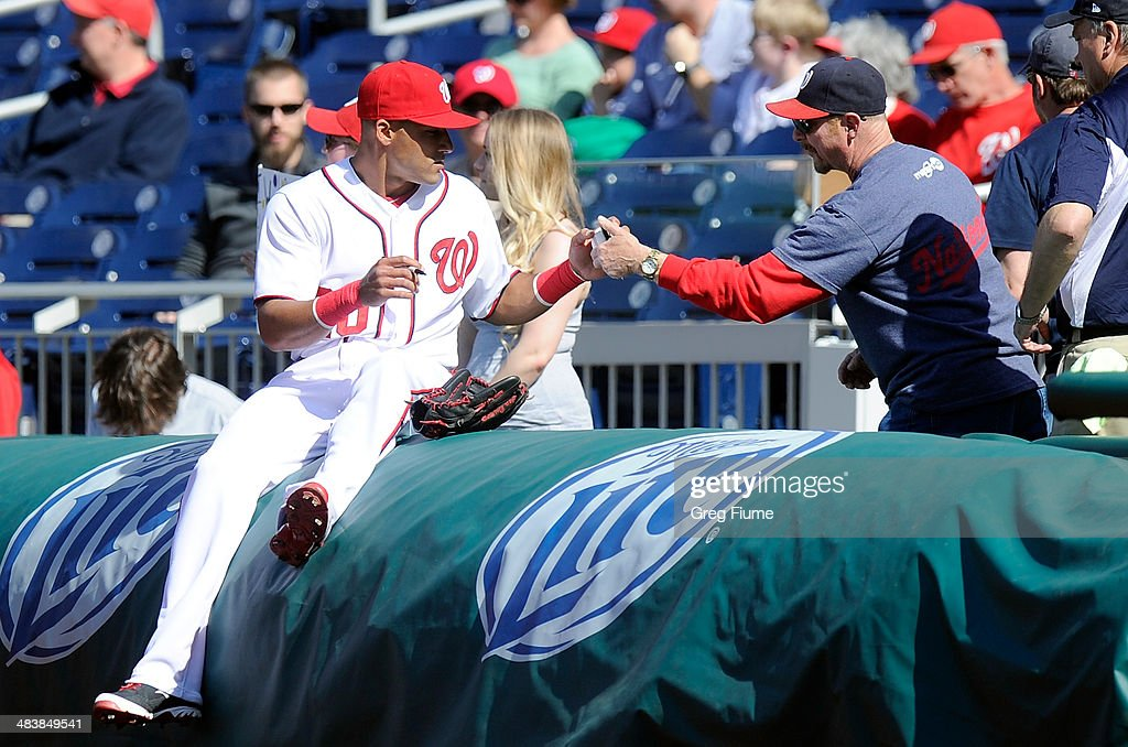 <a gi-track='captionPersonalityLinkClicked' href=/galleries/search?phrase=Ian+Desmond&family=editorial&specificpeople=835572 ng-click='$event.stopPropagation()'>Ian Desmond</a> #20 of the Washington Nationals signs autographs before the game against the Miami Marlins at Nationals Park on April 10, 2014 in Washington, DC.