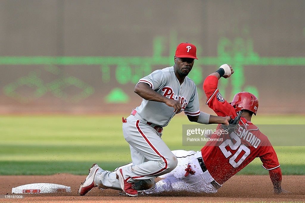 <a gi-track='captionPersonalityLinkClicked' href=/galleries/search?phrase=Ian+Desmond&family=editorial&specificpeople=835572 ng-click='$event.stopPropagation()'>Ian Desmond</a> #20 of the Washington Nationals steals second base against <a gi-track='captionPersonalityLinkClicked' href=/galleries/search?phrase=Jimmy+Rollins&family=editorial&specificpeople=204478 ng-click='$event.stopPropagation()'>Jimmy Rollins</a> #11 of the Philadelphia Phillies in the fourth inning during a game at Nationals Park on August 11, 2013 in Washington, DC.