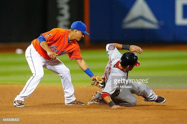 Ian Desmond of the Washington Nationals steals second base in the fifth inning ahead of the tag from Ruben Tejada of the New York Mets at Citi Field...