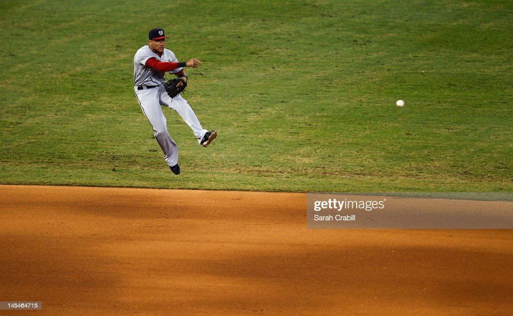 <a gi-track='captionPersonalityLinkClicked' href=/galleries/search?phrase=Ian+Desmond&family=editorial&specificpeople=835572 ng-click='$event.stopPropagation()'>Ian Desmond</a> #20 of the Washington Nationals throws during a game against the Miami Marlins at Marlins Park on May 30, 2012 in Miami, Florida. The Marlins defeated the Nationals 5-3.