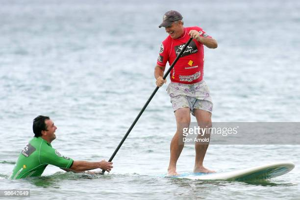 Ian 'Dicko' Dickson gets a friendly shove from Shannon Noll as he competes in the paddleboard competition during the Beachley Classic Celebrity...