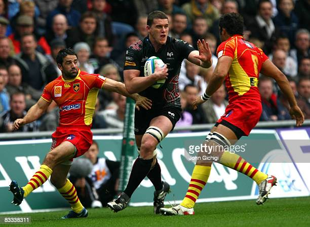 Ian Evans of Ospreys tries to avoid a tackle during the Heineken Cup game between Ospreys and Perpignan on October 18 1008 at The Liberty Stadium in...