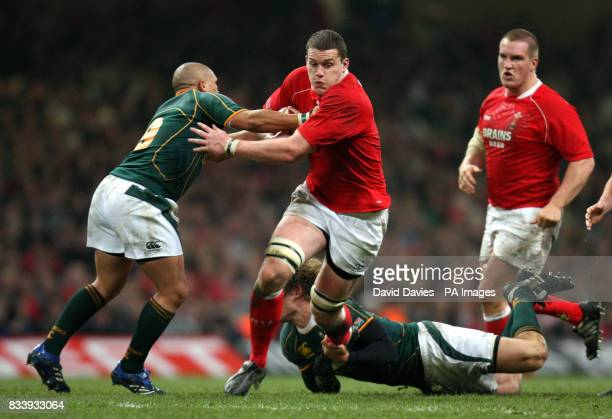 Ian Evans of Wales is tackled by Enrico Januarie and Francois Steyn of South Africa during the Prince William Cup match at the Millennium Stadium...