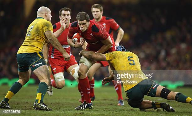 Ian Evans of Wales is tackled by James Horwill during the international match between Wales and Australia at the Millennium Stadium on November 30...