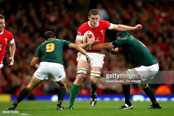 Ian Evans of Wales is tackled by Victor Matfield and Fourie Du Preez of South Africa during the Invesco Perpetual Autumn Series match at the...
