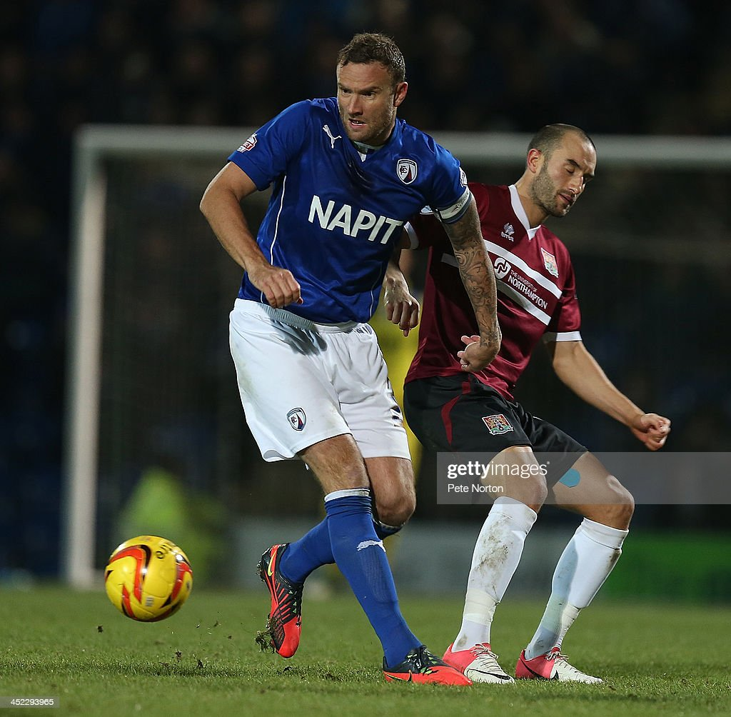 Ian Evatt of Chesterfield moves away with the ball from Chris Hackett of Northampton Town during the Sky Bet League Two match between Chesterfield and Northampton Town at Proact Stadium on November 26, 2013 in Chesterfield, England.