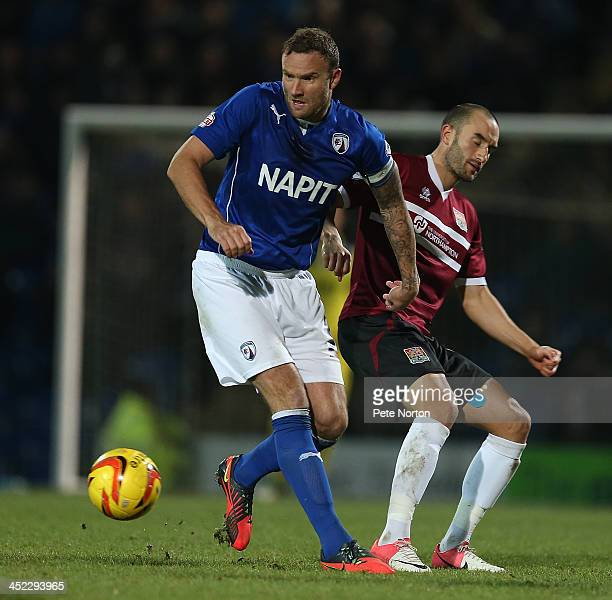 Ian Evatt of Chesterfield moves away with the ball from Chris Hackett of Northampton Town during the Sky Bet League Two match between Chesterfield...