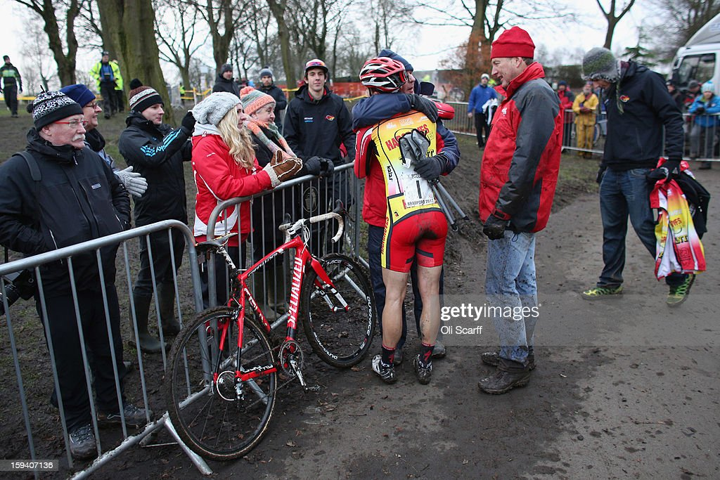 Ian Field (C) is congratulated after retaining his UK National Cyclocross Champion title at the 2013 National Cyclo-Cross Championships in Peel Park on January 13, 2013 in Bradford, England. The sport of cyclo-cross, featuring ,lightweight bikes with off-road tyres, has dramatically increased in popularity over the past few years. Cyclo-cross courses are often run over a mixture of terrains from tarmac to mud and frequently include obstacles or steep inclines where riders have to carry their bike.