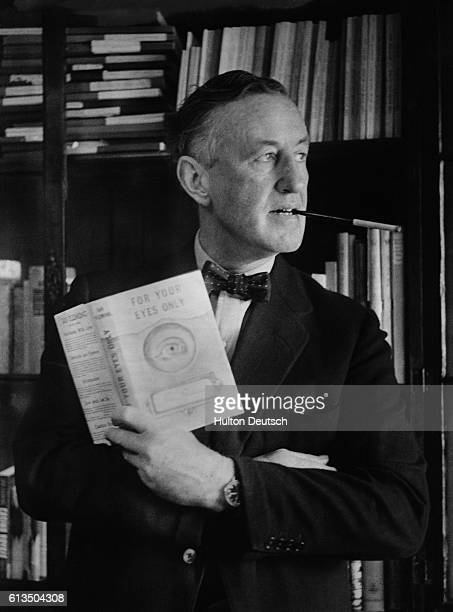 Ian Fleming the creator of the thriller hero James Bond poses with a copy of his latest novel For Your Eyes Only