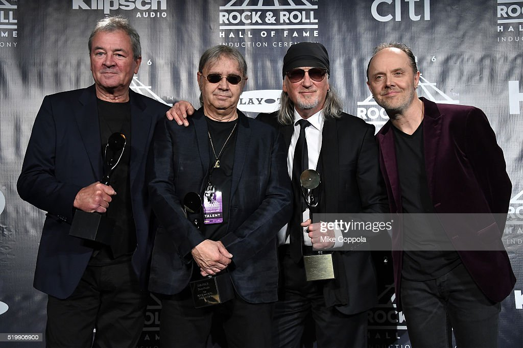 Ian Gillan, Ian Paice, and Roger Glover of Deep Purple pose with Lars Ulrich of Metallica on stage in the press room at the 31st Annual Rock And Roll Hall Of Fame Induction Ceremony at Barclays Center of Brooklyn on April 8, 2016 in New York City.