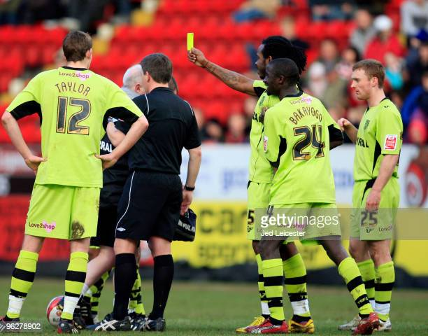 Ian Goodison of Tranmere Rovers showsthe referee the yellow card after he dropped it during the Coca Cola League One match between Charlton Athletic...