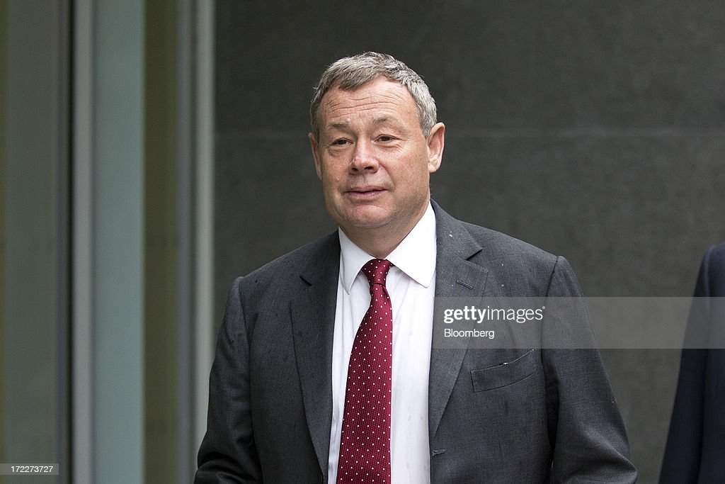 Ian Hannam, former global chairman of equity capital markets at JPMorgan Chase & Co., arrives to give evidence at the High Court in London, U.K., on Tuesday, July 2, 2013. Hannam is challenging the Financial Conduct Authority's proposed 450,000-pound civil market-abuse fine for insider trading at a court hearing in London. Photographer: Simon Dawson/Bloomberg via Getty Images